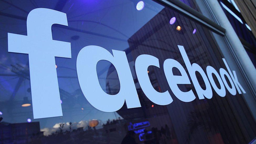 Facebook logo in window