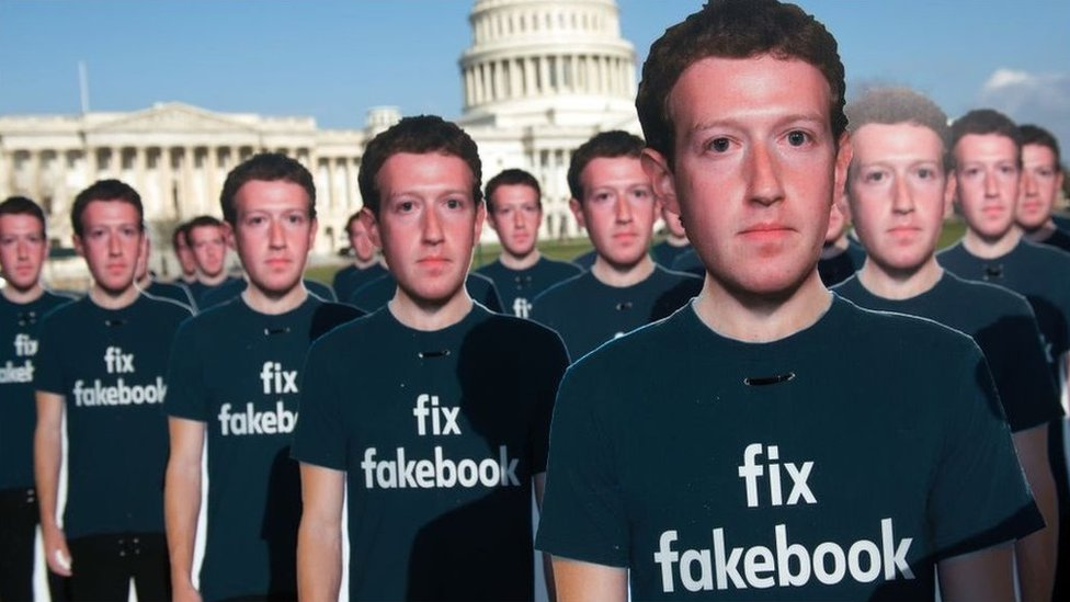 Cardboard cut-outs of Mark Zuckerberg at a demonstration outside the US Capitol building in April 2018