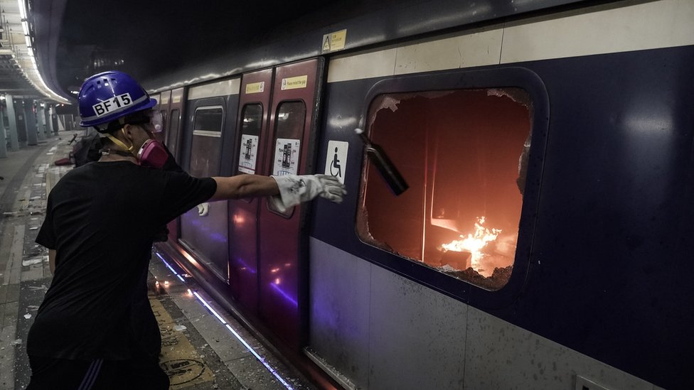"HONG KONG, CHINA - NOVEMBER 13: Pro-democracy protesters set fire to an MTR train car during a demonstration at Chinese University of Hong Kong on November 13, 2019 in Hong Kong, China. Anti-government protesters organized a general strike since Monday as demonstrations in Hong Kong stretched into its sixth month with demands for an independent inquiry into police brutality, the retraction of the word ""riot"" to describe the rallies, and genuine universal suffrage."