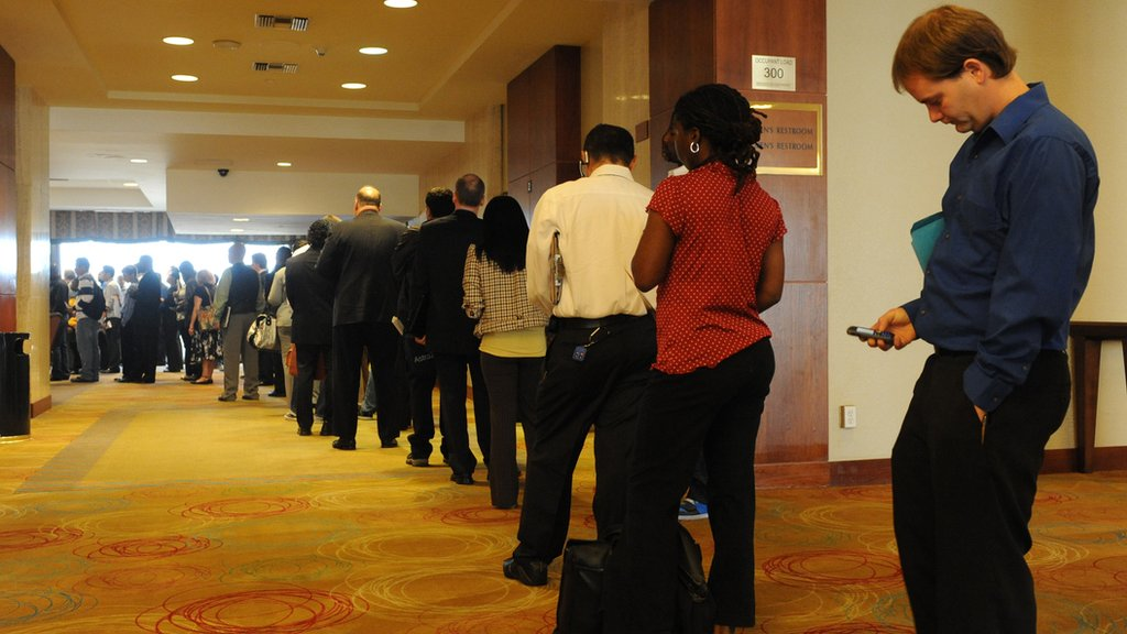Unemployed Americans line up to speak with a prospective employers at a Los Angeles career fair