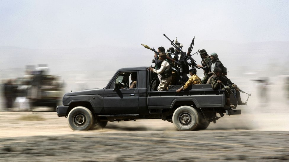 Armed Yemeni tribesmen loyal to the Shiite Huthi rebels sit in the back of an armed vehicle during a gathering to mobilise more fighters into several battlefronts on November 1, 2016