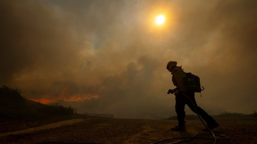 Firefighters are seen as the Silverado Fire approaches, near Irvine, California