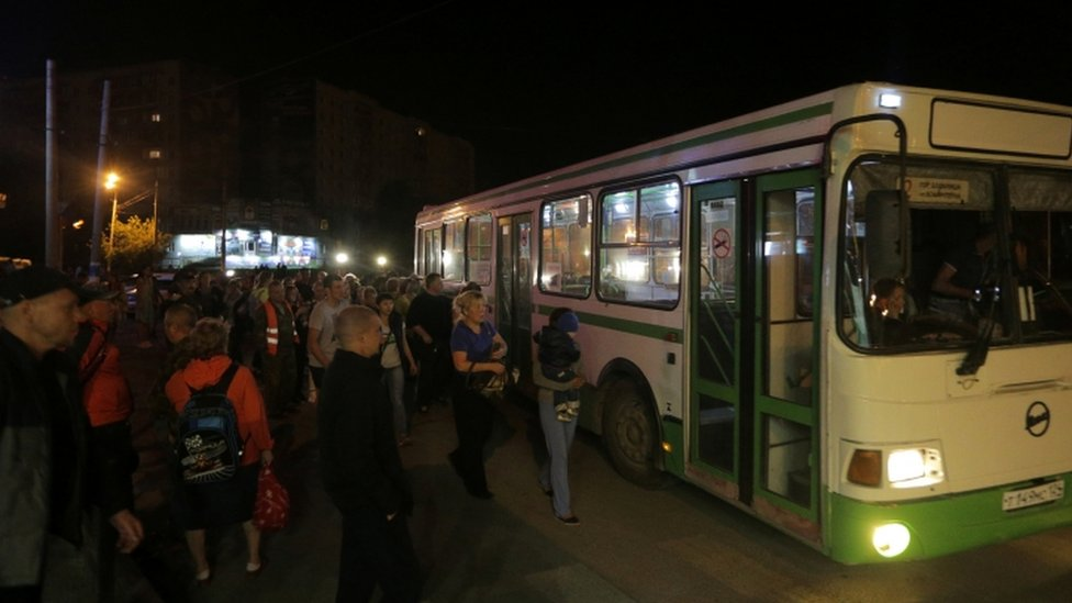 Bus evacuating residents of Achinsk