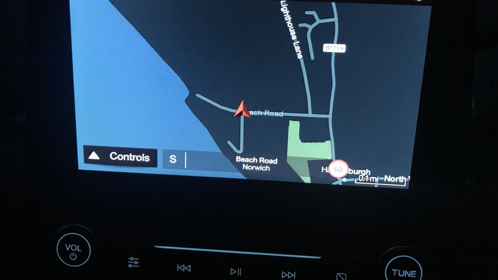 A sat-nav pinpoints the location of Darcy's house - notice how close it is to the sea,