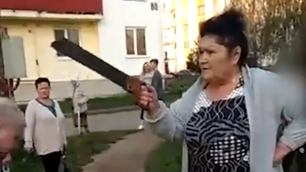 Woman with saw in Russia