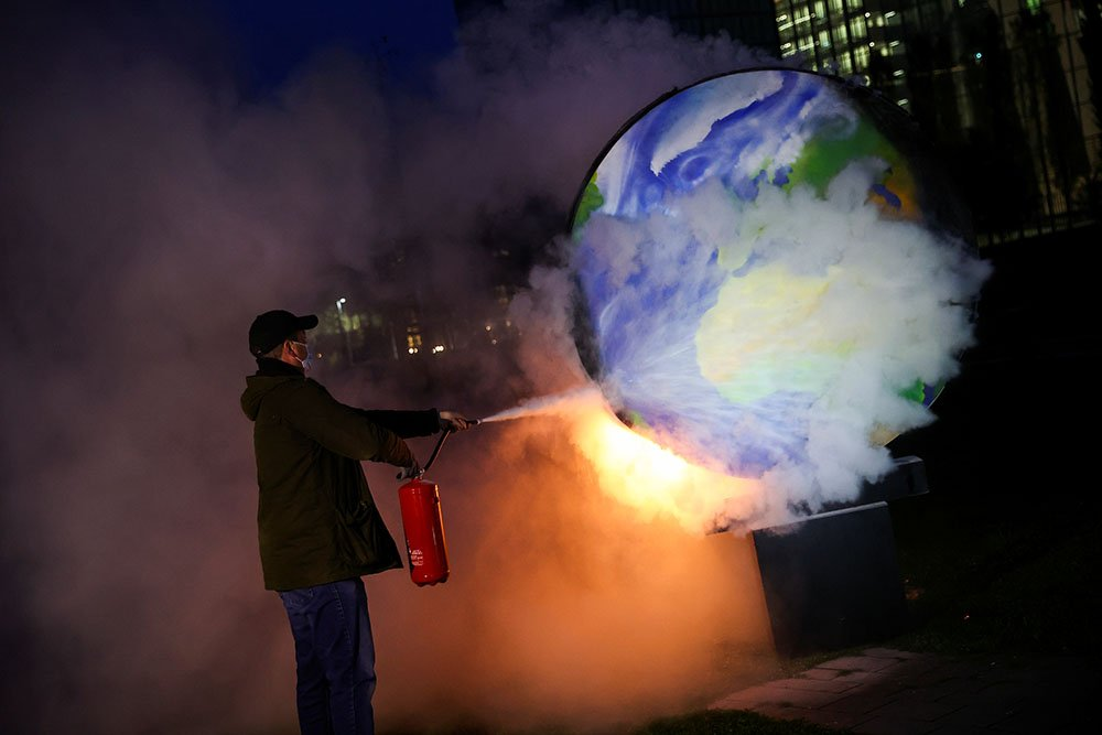 A demonstrator takes part in a protest against the fossil fuel industry in Frankfurt, Germany
