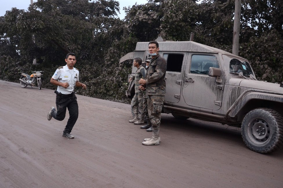 Police officers and soldiers work in El Rodeo village, Escuintla department, 3 June