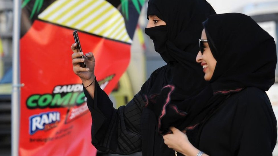 A Saudi woman uses her mobile in Jeddah on 16 February 2017