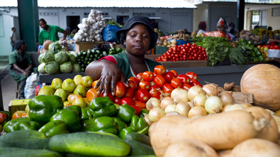 A woman handles fruit in the Maputo city market on January 11, 2014.
