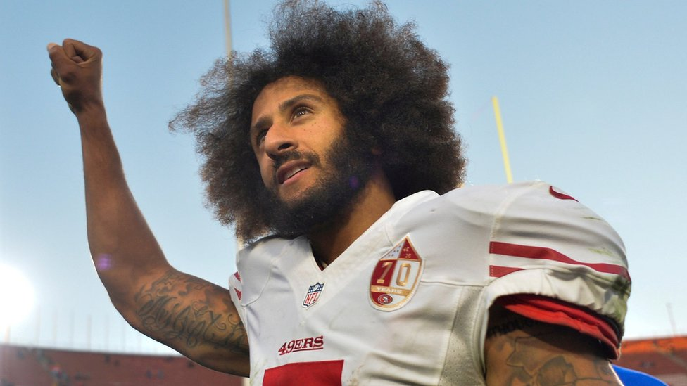 San Francisco 49ers quarterback Colin Kaepernick pumps his fist as he acknowledges cheers at Los Angeles Memorial Coliseum on December 24, 2016