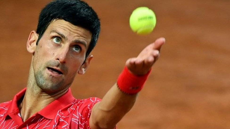 Novak Djokovic serves