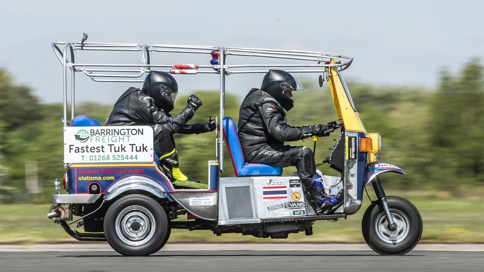 Essex businessman Matt Everard drives his tuk tuk during a world speed record attempt at Elvington Airfield, North Yorkshire.