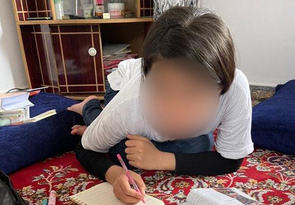 Parwana doing her home work