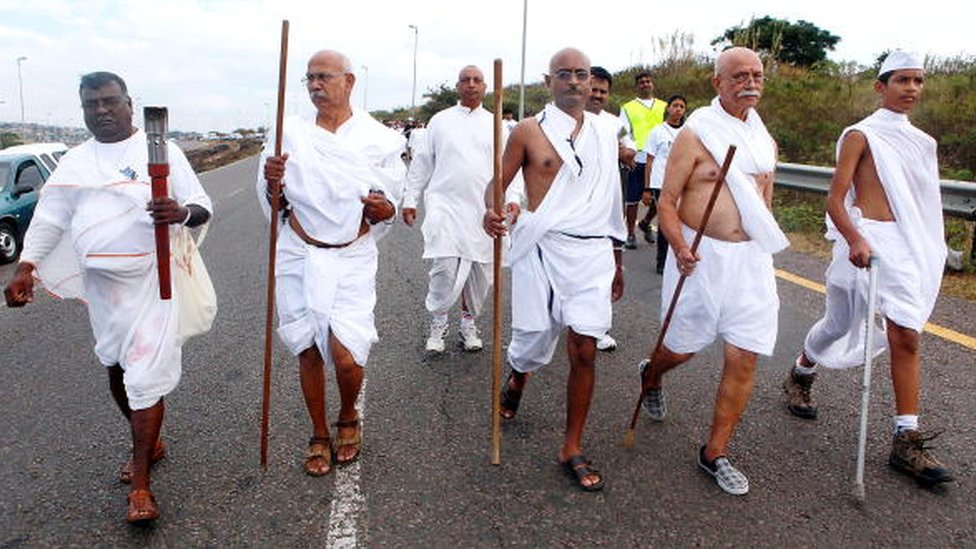 A few followers impersonate Gandhi during the annual Mahatma Gandhi Salt March on April 18, 2010 in Durban
