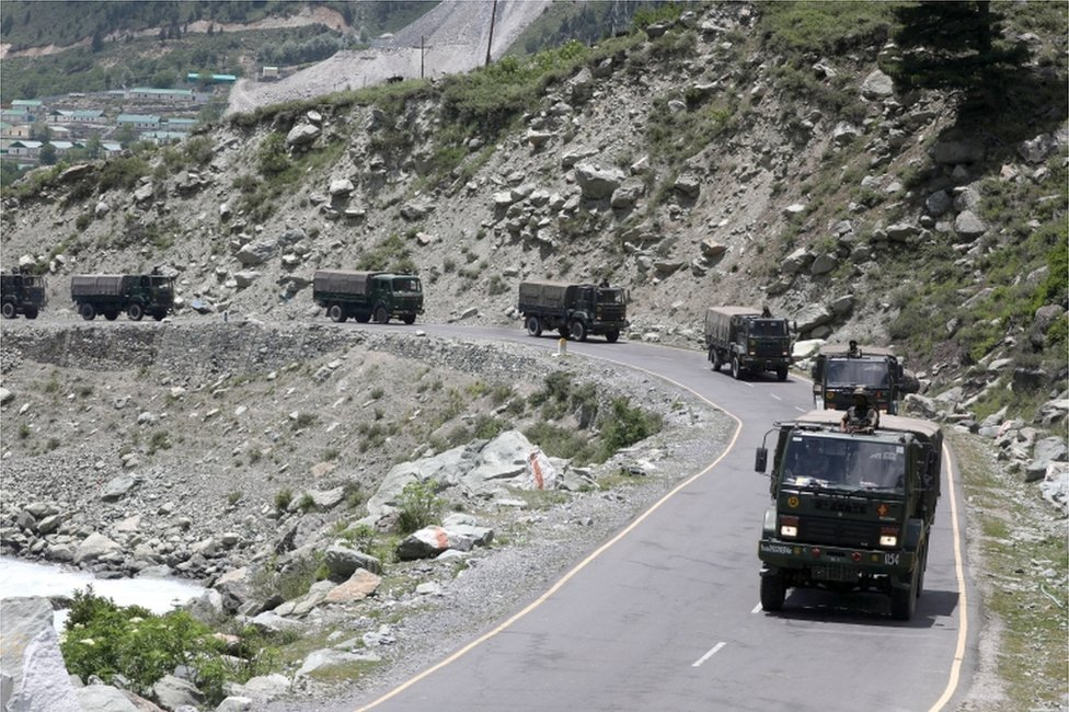Indian army trucks move along a highway leading to Ladakh, at Gagangeer some 81 kilometres from Srinagar,