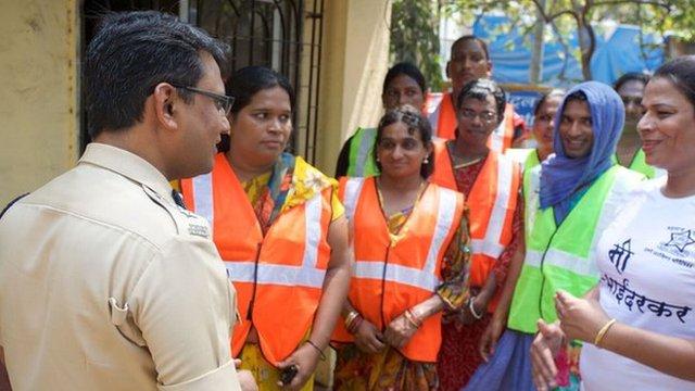 Policeman in India with transgender volunteers