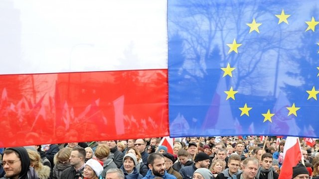 Protesters attend an anti government demonstration in Warsaw