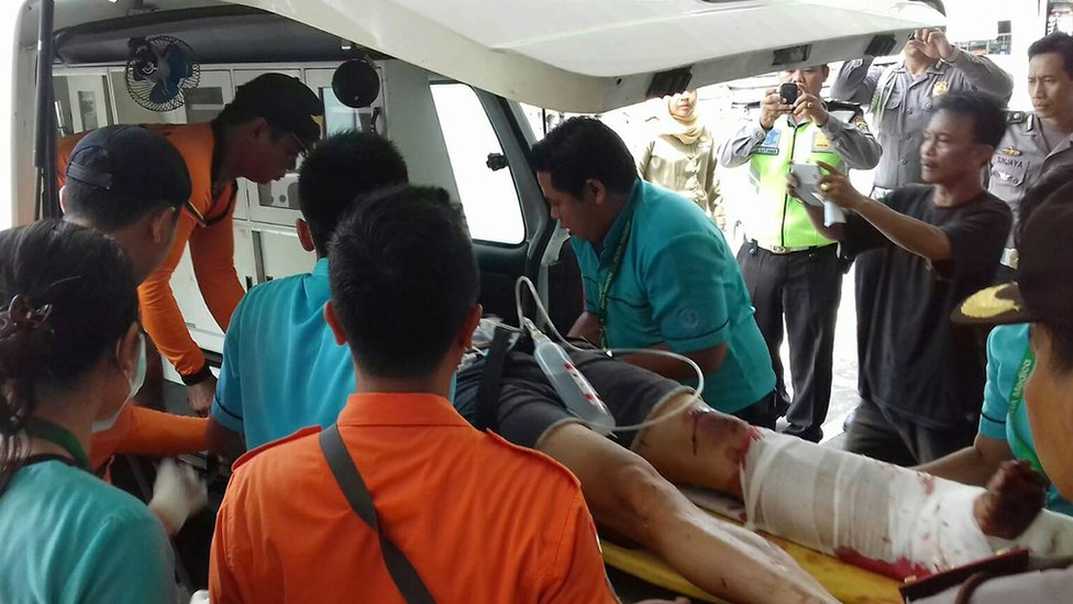 Injured person receives medical care after an explosion on a tourist boat off Bali, Indonesia, on 15 September