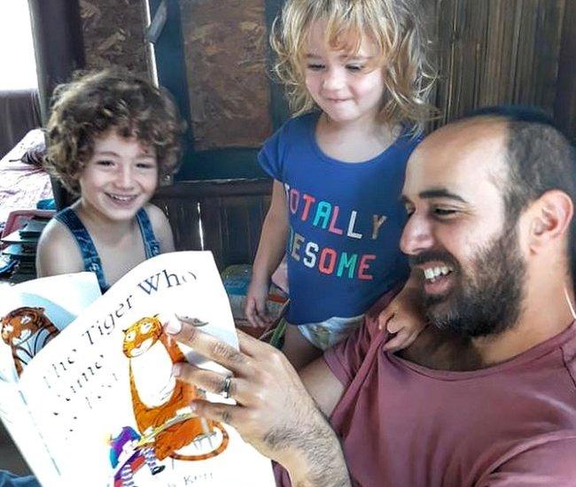 Yair reading to kids