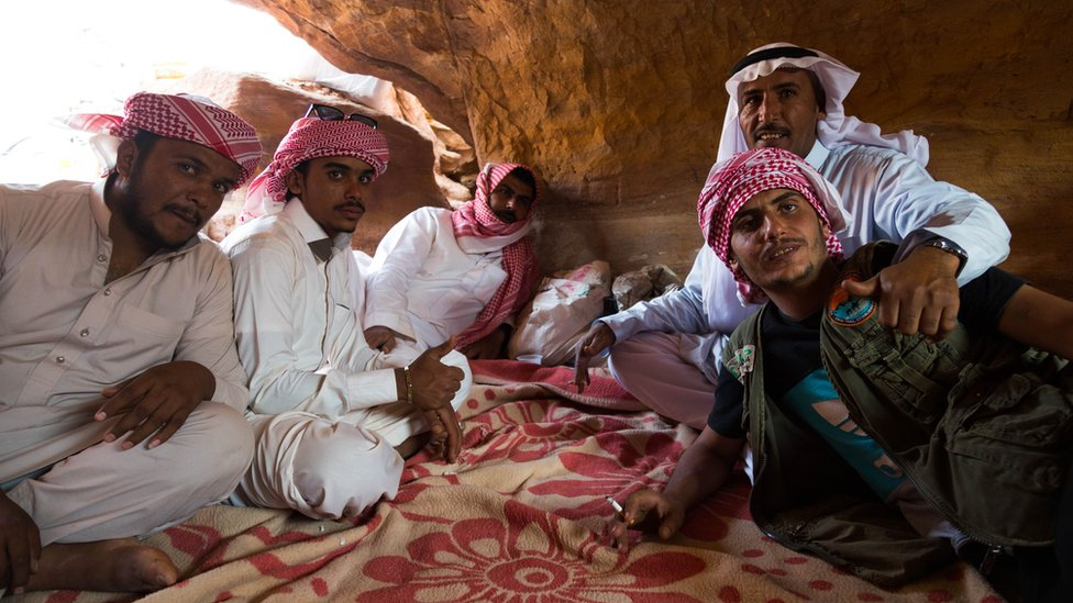 Tribesmen of the Muzeina and Alegat tribes sit in a cave