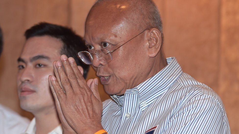 Suthep Thaugsuban, a key leader of anti-government street protests that led to the May 2014 military takeover, gives a traditional greeting to the media during a press conference in Bangkok on July 30, 2015
