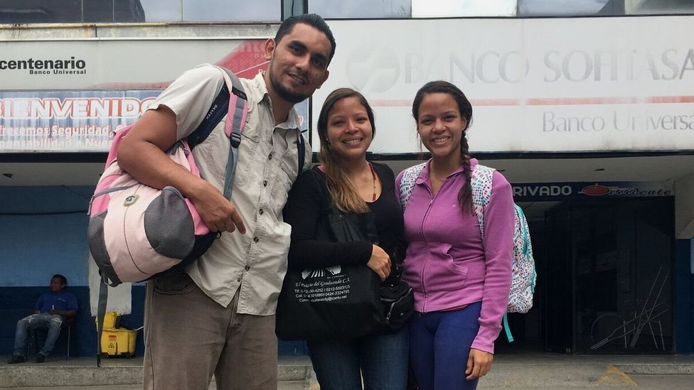 Victor, Claudia and Coraima pose at a bus station in Venezuela