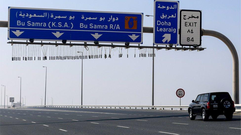 Vehicles drive on road leading to Qatar's land border crossing with Saudi Arabia at Abu Samrah (6 January 2021)