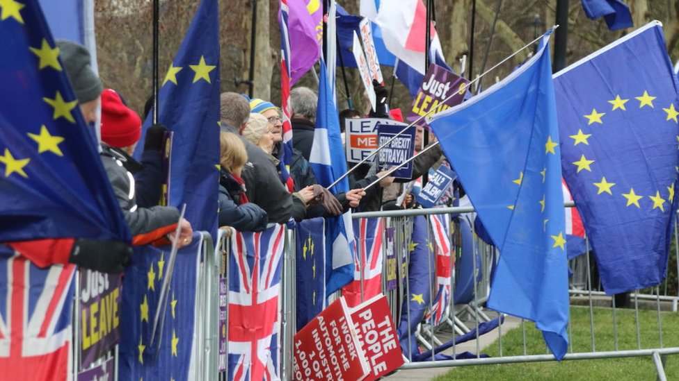 UK and EU Flags outside parliament