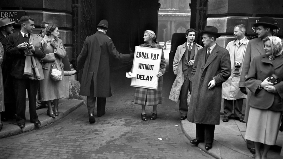 A woman protests for equal pay in London, 1952