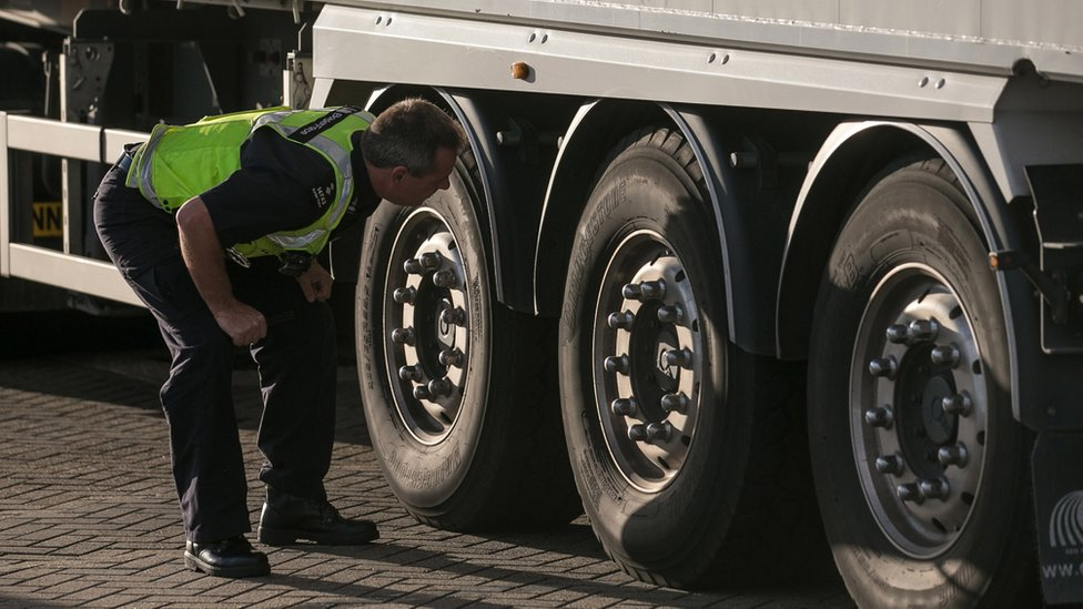UK Border Force officer checking a lorry