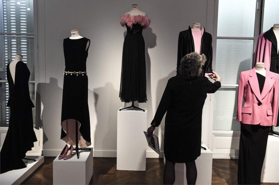 Several black dresses displayed together
