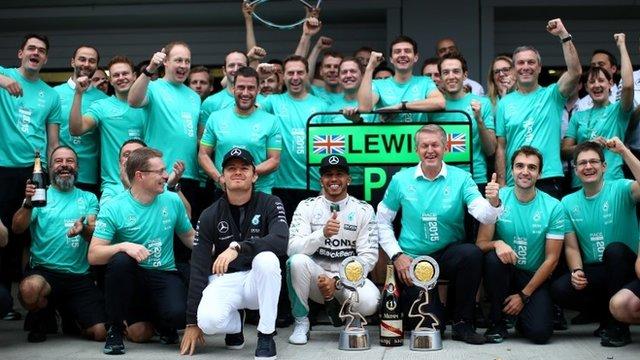 The Mercedes team celebrate Lewis Hamilton's win in Russia