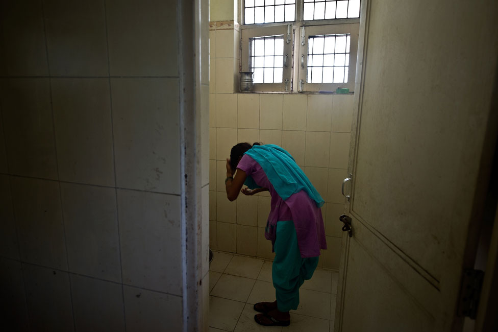 A child washes in a police station after being rescued from traffickers