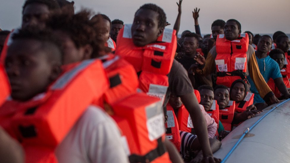 Refugees and migrants wait in a small rubber boat to be rescued off Lampedusa on 10 June, 2017