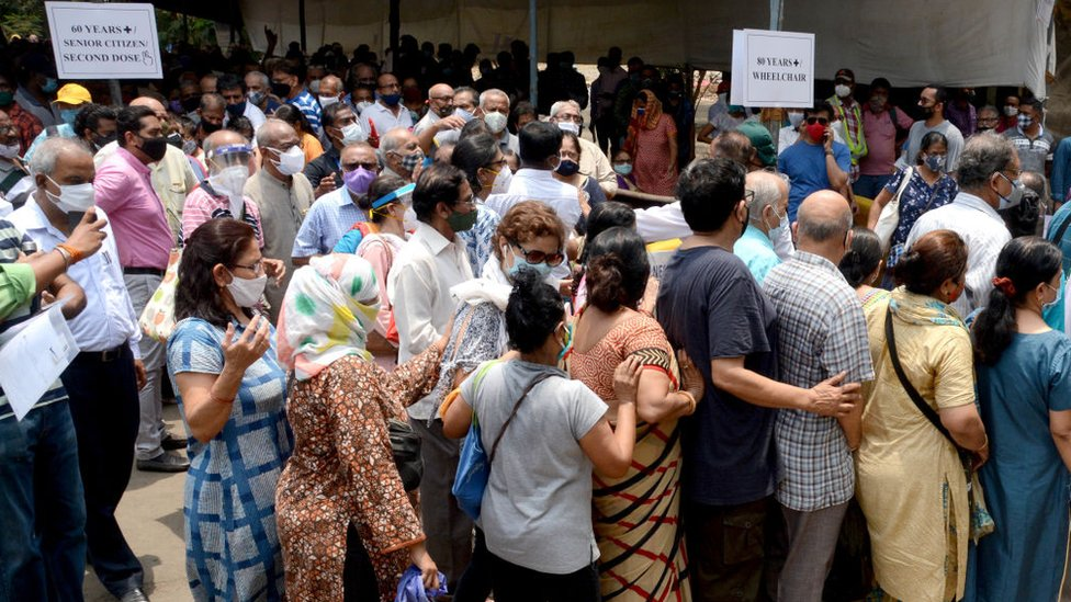 Beneficiaries above the age of 45 years waiting in long queue to get vaccinated at the NESCO Jumbo Covid-19 Vaccination Centre at Goregaon, on April 29, 2021 in Mumbai, India.