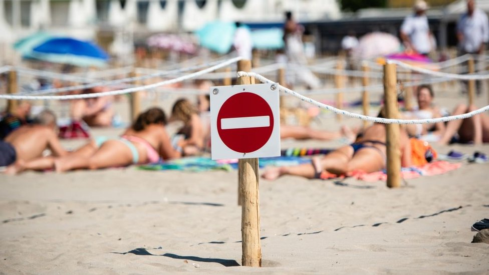 A sign on a beach in France