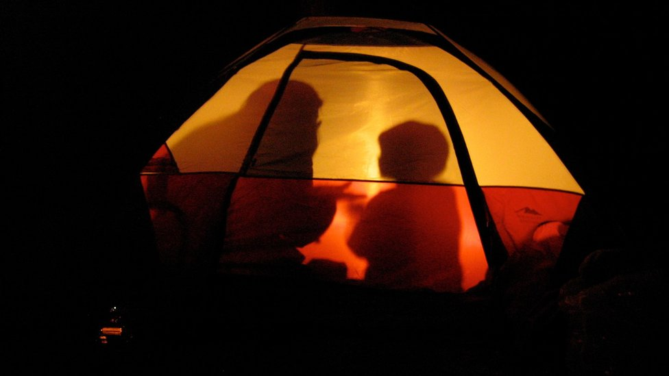 Mother and son in a tent