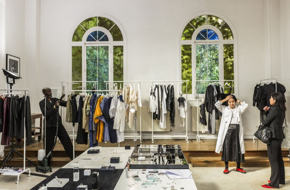 Clothes are seen on the rails of the Marche Noir shop in Paris.