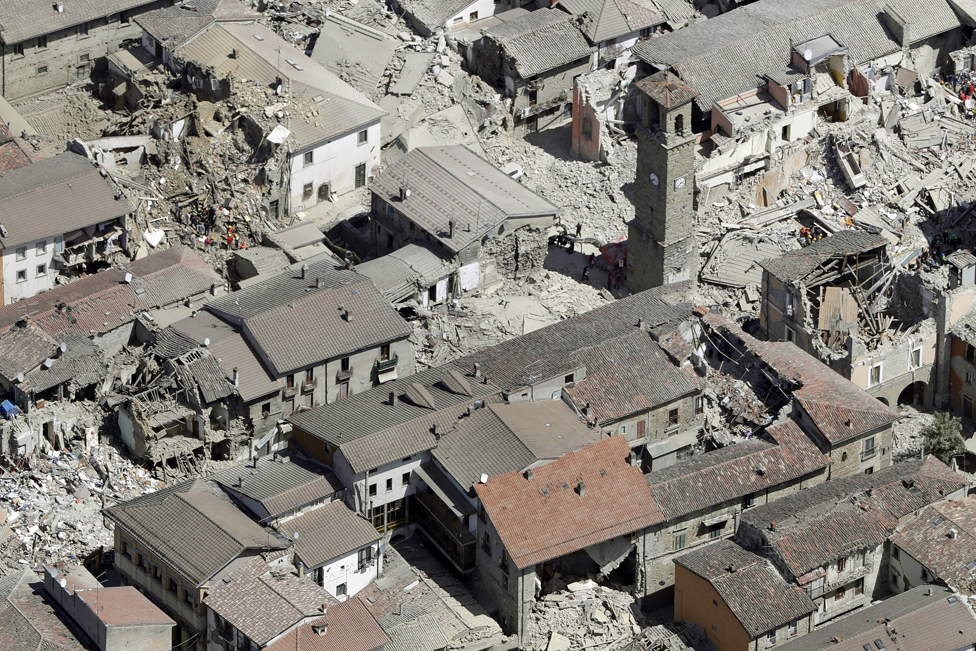 This aerial photo shows the damaged buildings in the centre of Amatrice - 24 August 2016