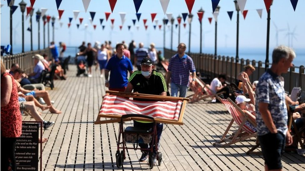People on Skegness Pier as the warm weather continues