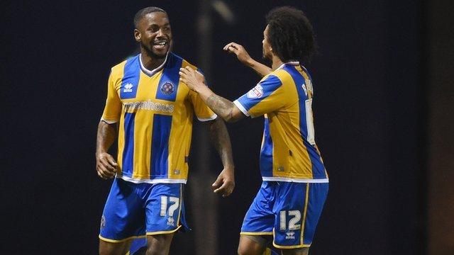 Shrewsbury Town's Abu Ogogo celebrates