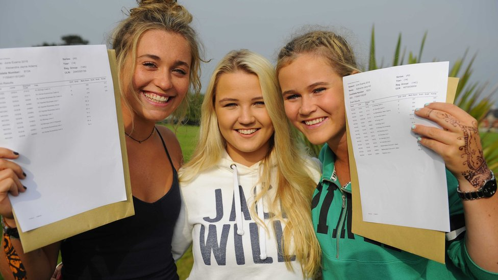 Happy students Alexandra Adams, Katie Fisher and Kathrine Hill pick up their results at Sullivan Upper