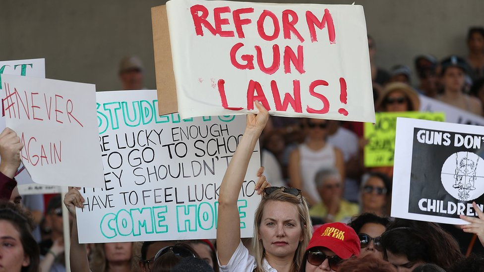 People join together after a school shooting that killed 17 to protest against guns on the steps of the Broward County Federal courthouse on 17 February 2018 in Fort Lauderdale, Florida.