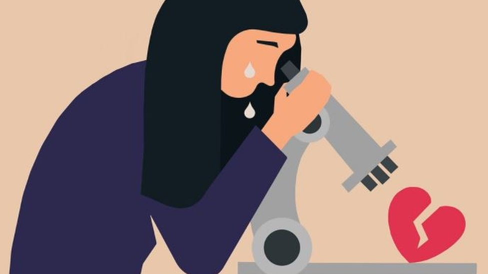 An illustration of a woman looking at a broken heart through a microscope