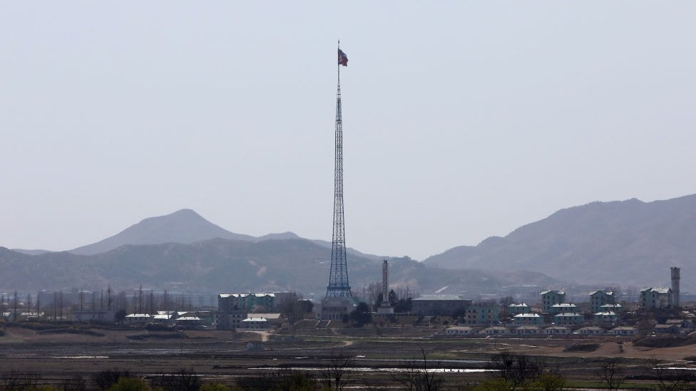 A North Korean national flag in North Korea's propaganda village of Gijungdong is seen from an observation post on April 11, 2018 in Panmunjom