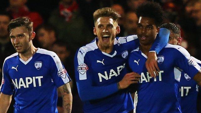 Chesterfield players celebrate Rai Simons' third goal