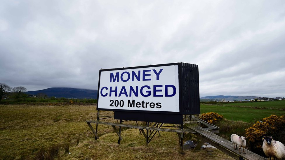 A billboard advertising pounds sterling to euros money changing services can be seen in Newry, Northern Ireland