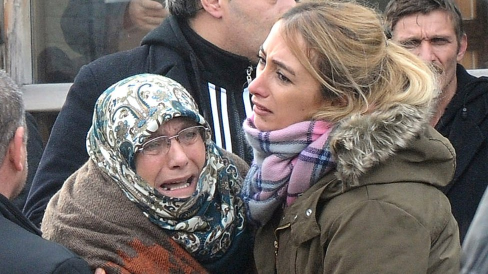 Family members of a victim cry outside the Forensic Medical Centre in Istanbul on 1 January 2017