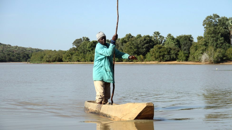 A fisherman on a fishing boat on Lake Wegnia in Koulikoro region, Mali - Saturday 23 November 2019