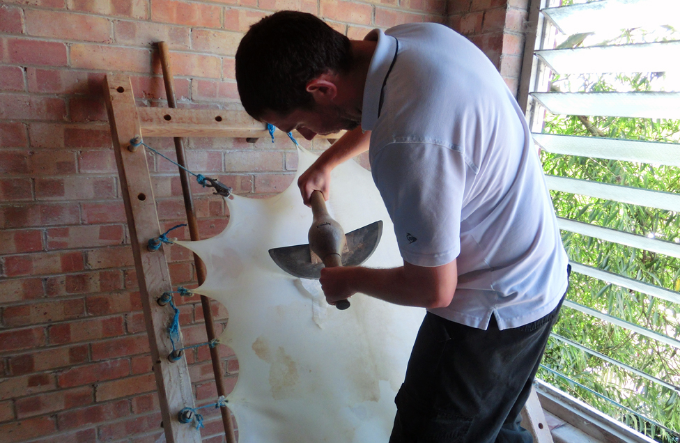 Lee Mapley of William Cowley Parchment Works works on vellum